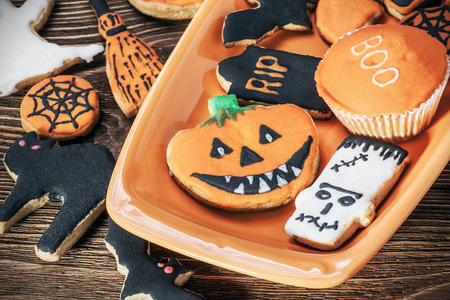homemade cookies: happy Halloween homemade cookies. Focus on the pumpkin cookies Stock Photo