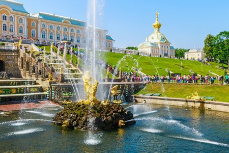 water view: ST PETERSBURG, RUSSIA - JUNE 21, 2015: Tourists in Peterhof fountains of the Grand Cascade. The Peterhof Palace