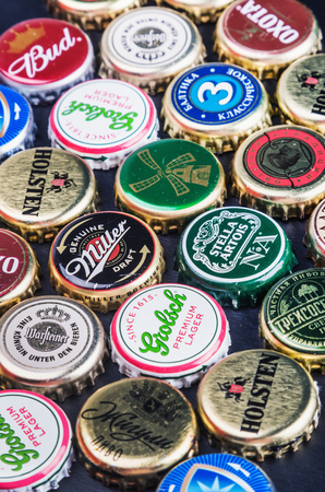 miller: Moscow, Russia - April 28, 2015: Background of beer bottle caps, a mix of various global brands: Grolsch, Bud, Bavaria, Miller, etc. Editorial