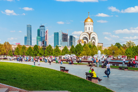 gorky: Moscow, Russia - May 10, 2015: People walking in the park of Victory in Moscow. Victory Park and Poklonnaya Hill - a memorial complex of the Great Patriotic War of 1941-1945. west of Moscow Editorial