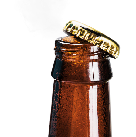 closed corks: open bottle of beer on a white background Stock Photo