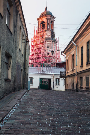 vyborg: old streets of Vyborg at dawn. Russia. Focus on building the clock tower in the center of the frame