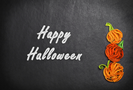 quilling: Quilling of pumpkins on a black background