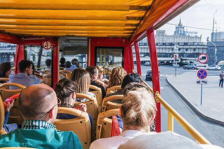 excursions: Moscow, Russia - September 27, 2015: Tourists and townspeople excursions in Moscow on a double Decker. Moscow is the capital of the Russian Federation, founded in 1147 Editorial