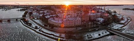 vyborg: View of the historic city of Vyborg from St. Olav tower, at dawn. Russia. Focus on the central building, photographed on a fisheye lens Stock Photo