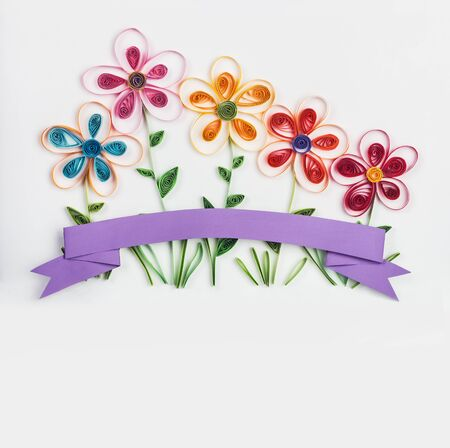 quilling: spring flowers made quilling on a light background