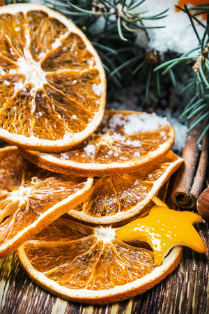 focus on the foreground: dried oranges with nuts and fir branches. Christmas decorations. focus foreground