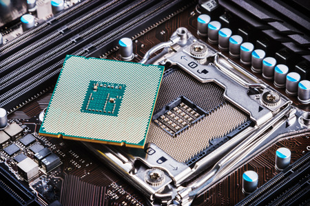 CPU socket and processor on the motherboard Stock Photo