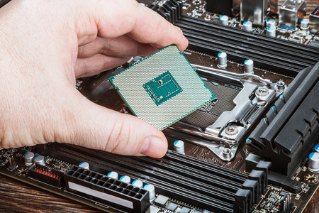 CPU in hand before installation into the motherboard Stock Photo