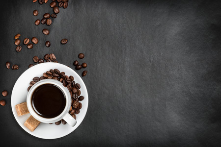coffee cup on a black background with coffee beans Archivio Fotografico