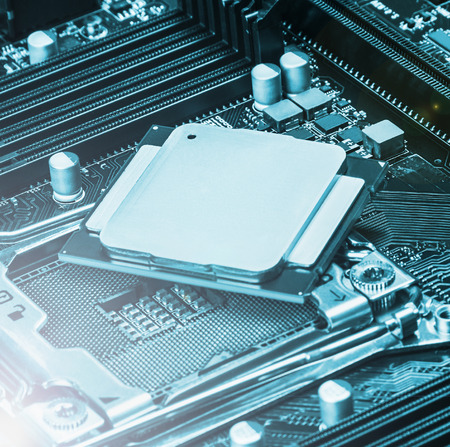CPU socket and processor on the motherboard. focus on top of CPU. Toned image Stock Photo