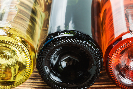 bottles of wine of different sorts. Focus in the middle of the frame. Shallow depth of field