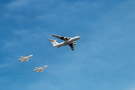 frontline: Moscow, Russia - May 7, 2015: The aircraft tanker Ilyushin Il-78 and strategic bombers Tu-22M3 (Backfire) in the sky Russian fighters, from training to the parade on May 9.