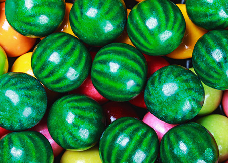 gumballs: colored chewing gum in the form of a water-melon background Stock Photo