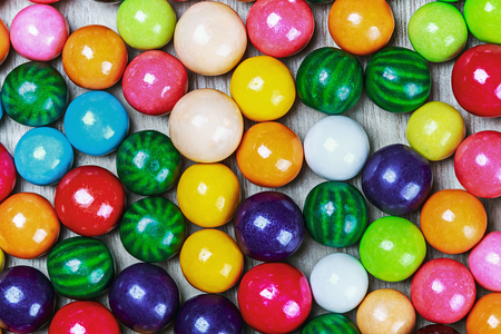 multicolored gumballs: balls of colored chewing gum background Stock Photo