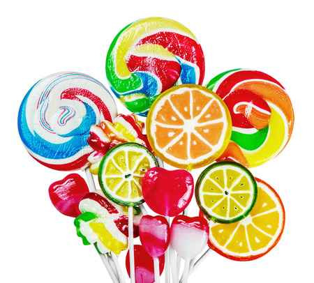 Colorful candies and lollipops isolated on white background. focus on large lollipops