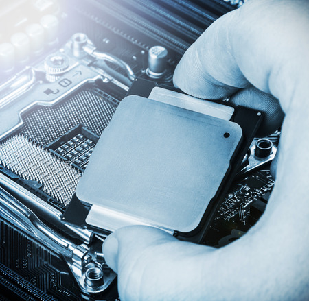 CPU in hand before installation into the motherboard. Toned image Stock Photo