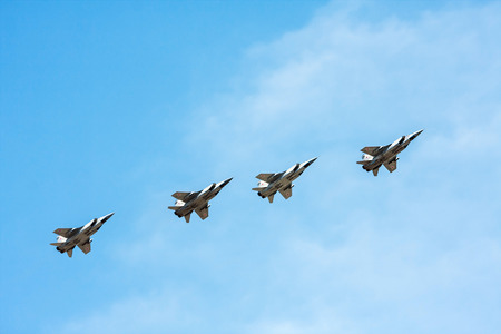 first plane: Moscow, Russia - May 7, 2015: group flight of russian fighter aircraft MiG-31, from training to the parade on May 9th. focus on the first plane
