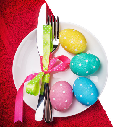 pascha: colored Easter eggs on a white background. focus on the plate with eggs Stock Photo