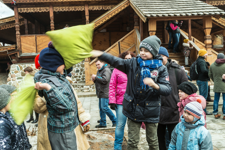 childs: Moscow, Russia - March 13, 2016: childs play pillow fight on maslenitsa in the Izmailovo Kremlin in Moscow. People walk, dance, play, participate in contests