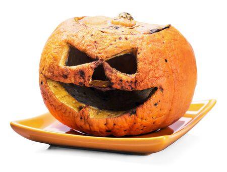 rotten pumpkin lantern jack isolated on white background Stock Photo