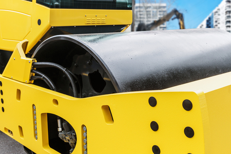 steam roller: Construction compactor in the operation site closeup