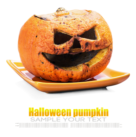Jack lantern pumpkin for Halloween isolated on a white background. Tex example