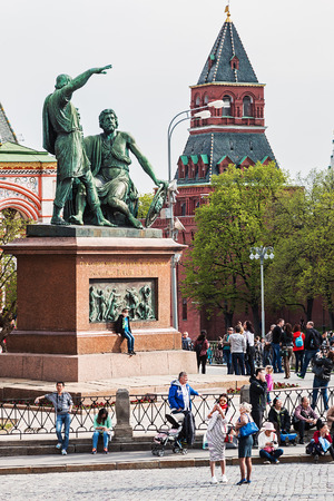 minin: Moscow, Russia - May 2, 2016: Tourists and citizens walking in the Moscow Kremlin. Monument to Minin and Pozharsky in St. Basils Cathedral of Kremlin fortress, Russia. Editorial