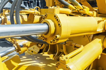 hydraulics tractor yellow. focus on the hydraulic pipes 스톡 콘텐츠