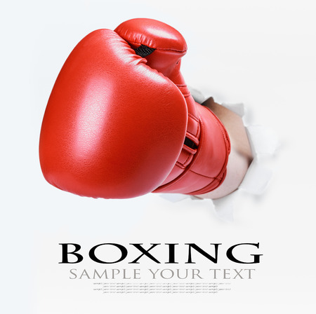 deleted: hand in boxing glove broke through the paper wall. text deleted Stock Photo