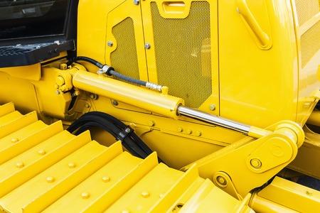 hydraulics: hydraulics tractor yellow. caterpillar bulldozer