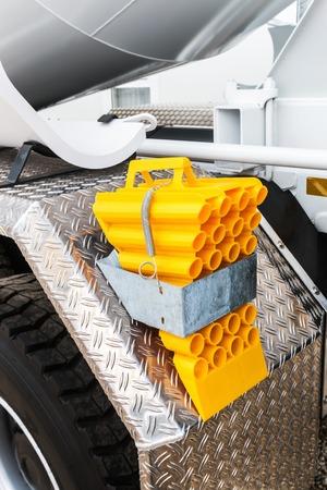 yellow block: yellow locking block for truck. Focus on the block