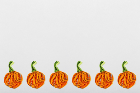 quilling: Pumpkins in quilling techniques for Halloween on a light background Stock Photo