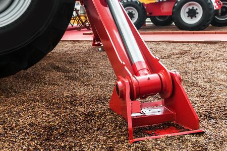 hydraulics: hydraulics crane support. hydraulics crane support is on gravel. focus on the hydraulics crane support