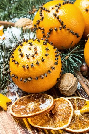 christmas decorations and christmas oranges on a wooden table and snow stock photo 66524084 - Christmas Oranges