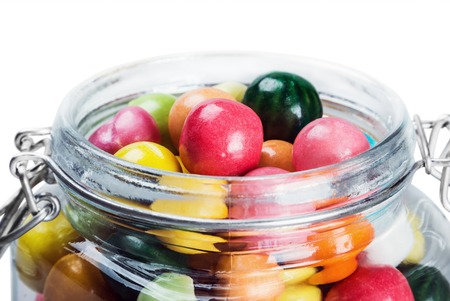 Colorful candies and chewing gum in glass jar Stock Photo