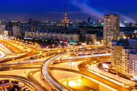 Traffic on the night streets of Moscow. Architecture and new areas with height Stock Photo