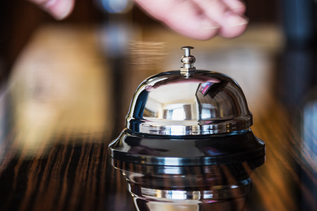 Hotel Concierge. service bell in a hotel or other premises 스톡 콘텐츠