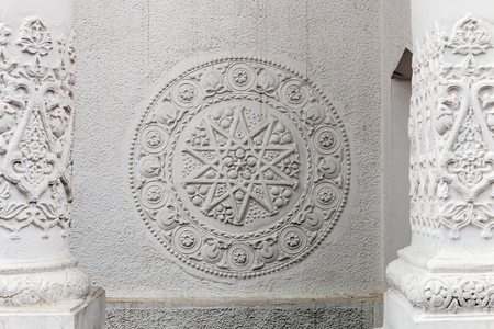 Bas-reliefs and sculptural details in the design of stone art Stock Photo
