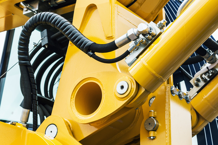 hydraulics pipes and nozzles, tractor or other construction equipment. focus on the hydraulic pipes Imagens