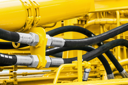 hydraulics pipes and nozzles, tractor or other construction equipment. focus on the hydraulic pipes Banco de Imagens