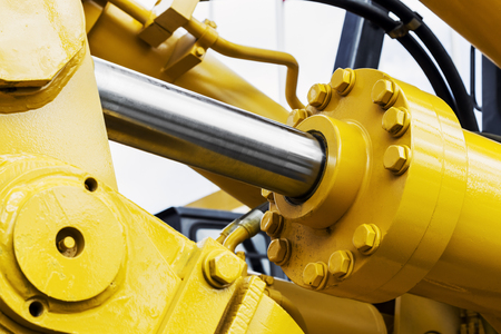 hydraulics tractor yellow. focus on the hydraulic pipes Stockfoto