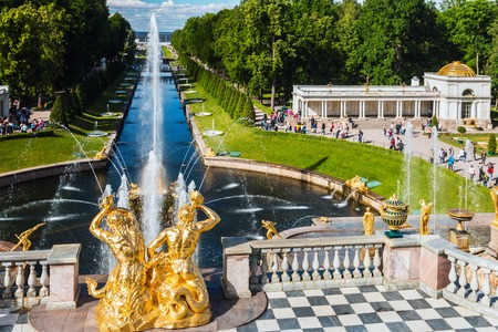 ST PETERSBURG, RUSSIA - July 07, 2017: Tourists in Peterhof the fountains of the Grand Cascade. The Peterhof Palace included