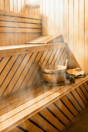 wooden sauna cabin with sauna accessories, bucket, broom, oak, scoop Banque d'images