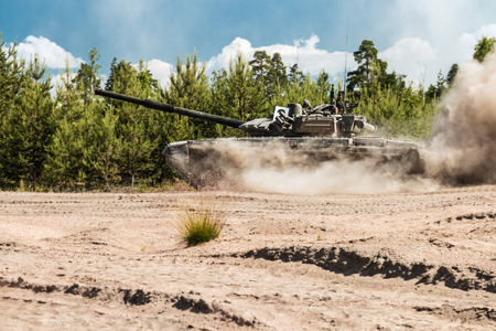 Main Battle Tank Russia are going to dust on a forest road in military exercises Editorial