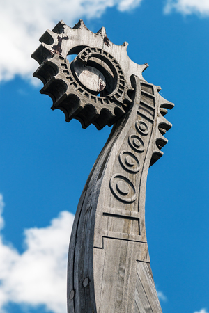 head of a sun on the front of the Viking ship Drakkar. focus on the head