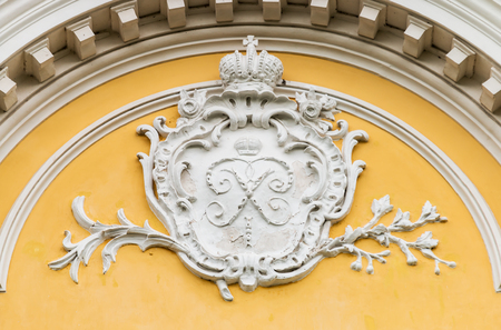 monogram of Peter I on building freylinsky house in Peterhof, Saint Petersburg. Russia Stock Photo