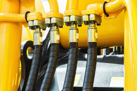 hydraulics tractor yellow. focus on the hydraulic pipes Stock fotó