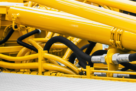 pipes and the hydraulic system of the tractor or excavator Stock Photo