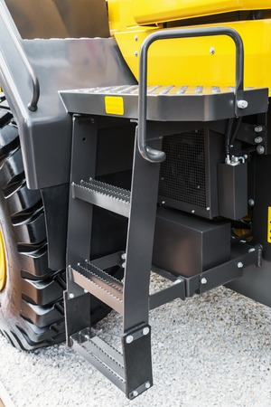 step into the cab of the tractor or other construction equipment Stock Photo